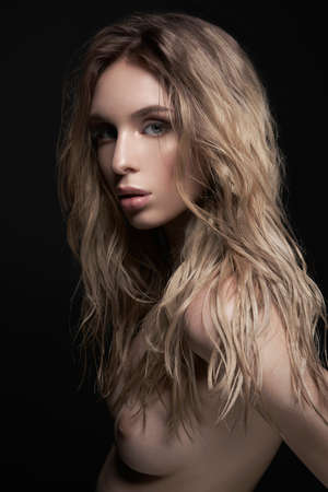 Foto de Young beautiful blonde with sexual body. Erotic portrait of sexy woman. Attractive model with classic style hairstyle. Pretty girl with professional makeup and hairdress. - Imagen libre de derechos