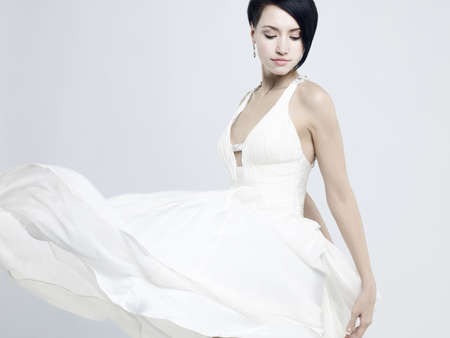Photo for Fashionable photo of beautiful young lady in a billowing white dress - Royalty Free Image