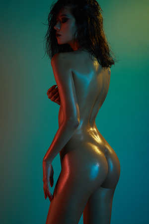 Photo for fashion art photo of elegant nude model in the light colored spotlights - Royalty Free Image