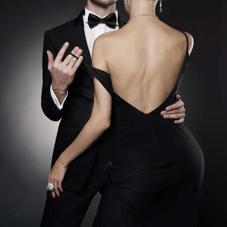 Photo pour Conceptual photo of sexy elegant couple in the evening suit and dress. dancing lovers pose in photography studio. - image libre de droit