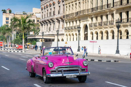 Photo for Classic cars are used in the tourist industry in Cuba with great success as well as colonial buildings. Cuba. January 10, 2020. - Royalty Free Image