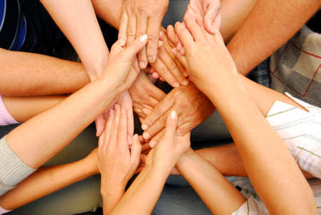 Photo pour reaching and touching hands, non verbal communication and symbol for solidarity - image libre de droit