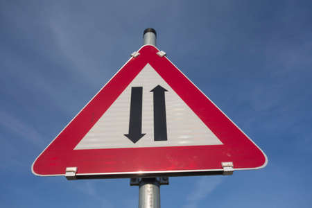 Photo for attention two way traffic or oncoming traffic road sign, red triangle as warning notice - Royalty Free Image