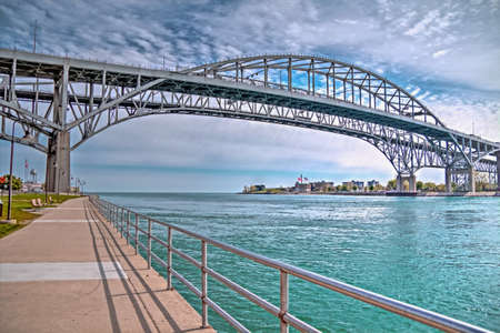 The twin spans of the Blue Water Bridges connect the cities of Port Huron, Michigan and Sarnia, Ontario  They are the second busiest crossing between the two countries with the Ambassador Bridge in Detroit being the busiest