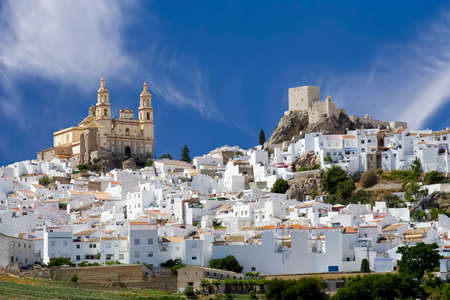 Olvera is a white village (pueblo blanco) in Cadiz province, Andalucia, Spain.  It features a moorish fortress and a neoclassic cathedral overlooking the whitewashed village.