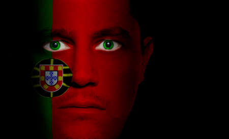 Portuguese flag painted/projected onto a man's face.