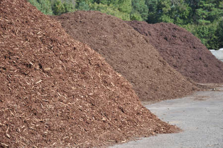three different types of mulch offered for sale at a garden supply center