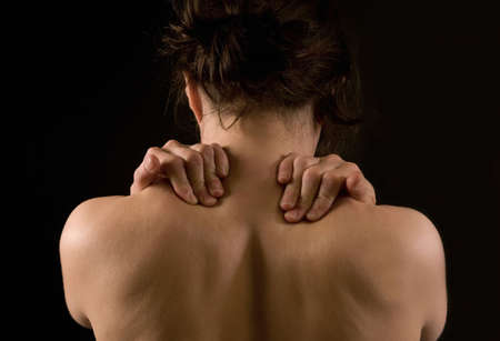 woman massaging her neck and back