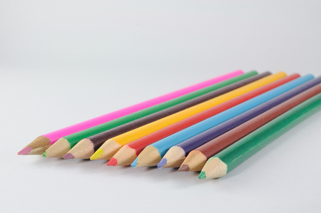 Multi colors wood-pencils on white background.