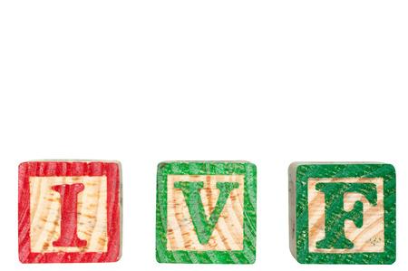I V F character wooden blocks isolated on white background