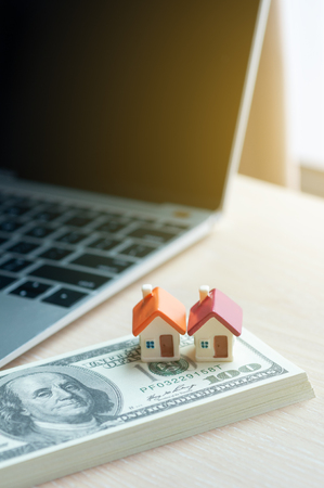 Photo pour Real estate business concept, dollar banknote with miniature house mortgage, modern online marketing in real estate business. - image libre de droit