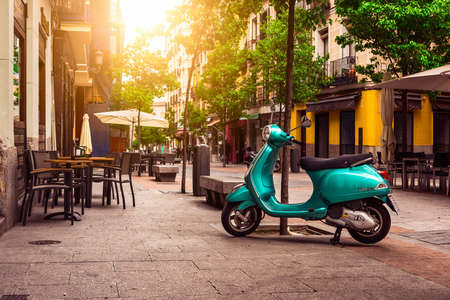 Photo for Madrid, Spain - May 10, 2016: Scooter Vespa parked on old street in Madrid, Spain - Royalty Free Image
