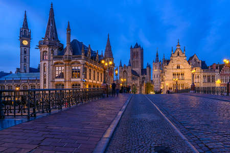 Foto de Medieval city of Gent (Ghent) in Flanders with Saint Nicholas Church and Gent Town Hall, Belgium. Nigth cityscape of Gent. - Imagen libre de derechos