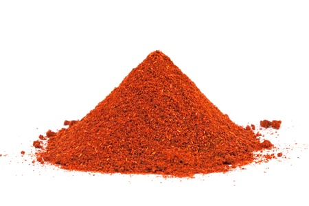 Pile of ground Paprika isolated on white background  Used to color rices, stews, and soups, meats