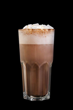 Cocoa with whipped cream, marshmelow, marshmallow in a high glass glass, side view, isolated black background