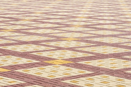 Texture, background, colorful area lined with paving slabs