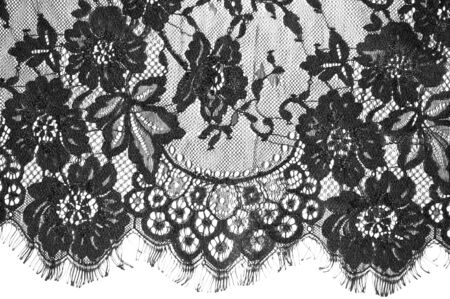 Photo pour exture background, pattern. black lace fabric. This beautiful lace fabric is perfect for your design, overlays, accents and wallpapers. It has a jagged border along both edges adorned with filaments - image libre de droit