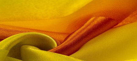 Foto de Texture, background, yellow silk striped fabric with a metallic sheen. If you have a bad mood, this fabric will lift it to unprecedented heights. Your project will be successful. - Imagen libre de derechos