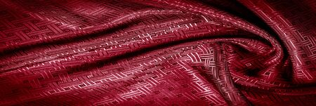 Foto de Background texture, pattern. Red silk fabric with a small checkered pattern. A classic look, add this to your designer collection. If you are looking for a red runway, you can learn how to go. - Imagen libre de derechos
