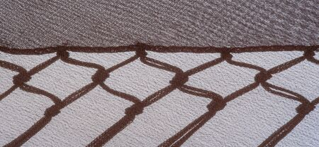 Photo pour Background texture of silk fabric. This is a natural brown scarf, this beautiful nylon satin made of artificial silk with a clear hand and a wonderful sheen is perfect for your projects. - image libre de droit