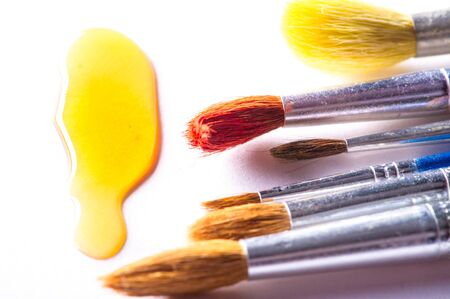 The artist paints with brushes. easel. watercolor. White background. The one who creatively works in a-n. field of art.