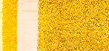 Photo pour Texture background, pattern. fabric; yellow gold brocade. Organza brocade fabric - shepherd, with a crunchy palm. It has a large yarn-dyed flower embroidered pattern throughout. - image libre de droit