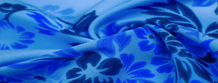 Photo pour delicate blue silk with floral print Exceptionally lightweight pure silk fabric with a delicate texture. Clean, use lining when opacity is desired. - image libre de droit