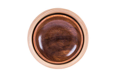 Close up top view of two wooden empty bowls nested, isolated on white background.
