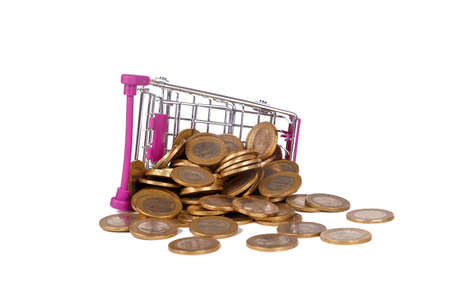 Stack of Turkish Lira coins in shopping cart with money consuming and finance concept, isolated on white background.