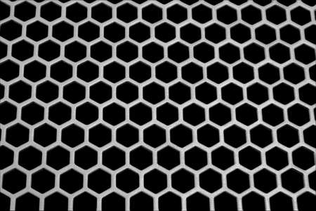 Aluminum honeycomb lattice in the form. Close-up. On a black background.