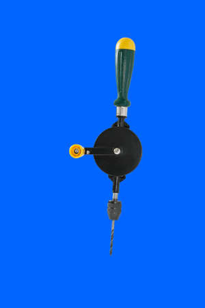 New hand drill. Isolated on a blue background.