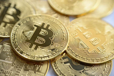 Foto de Golden bitcoin close-up. cryptocurrency coin - Imagen libre de derechos
