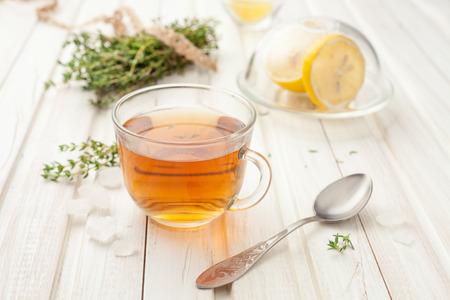 Photo pour herbal teas with lemon and thyme on the garden table - image libre de droit