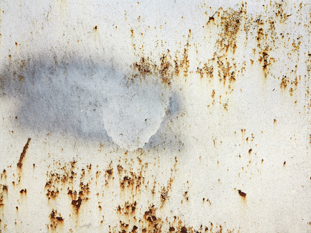 Photo pour Bright multi-colored paint on rusty metal surface. Rusty metal wall, old sheet of iron covered with rust with multi-colored paint. As textured authentic background for your project - image libre de droit