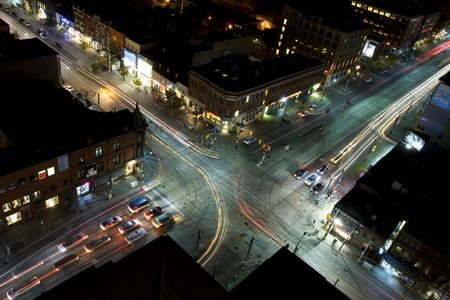 Midnight traffic as seen from rooftop reverse