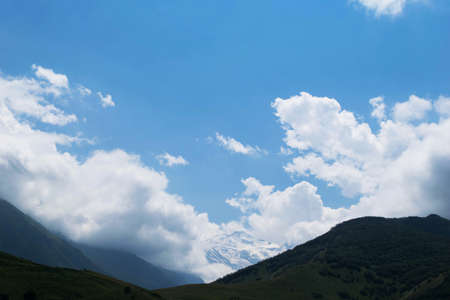 Photo pour View of the mountains of the North Caucasus. Mountains in the clouds in summer - image libre de droit
