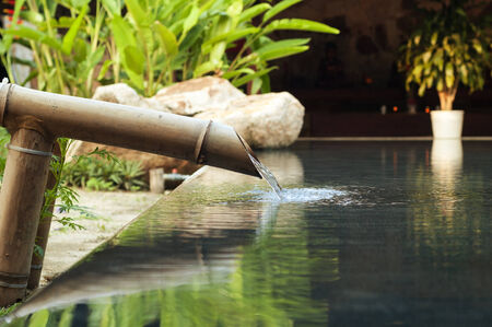 water falling down from bamboo pipe.