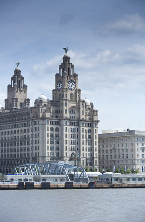 Liverpool skyline, a scene across the River Mersey showing Pier Head, with the Royal Liver Building, Cunard Building and Port of Liverpool Building