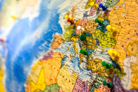 Photo pour Lot of push pins pointing at European countries, Russian map. - image libre de droit
