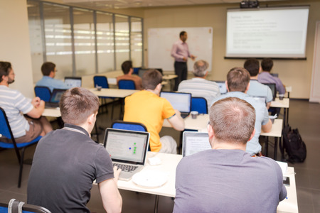 Photo for rear view of the students in computer class - Royalty Free Image
