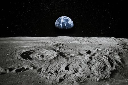 Foto de View of Moon limb with Earth rising on the horizon. Footprints as an evidence of people being there or great forgery. - Imagen libre de derechos