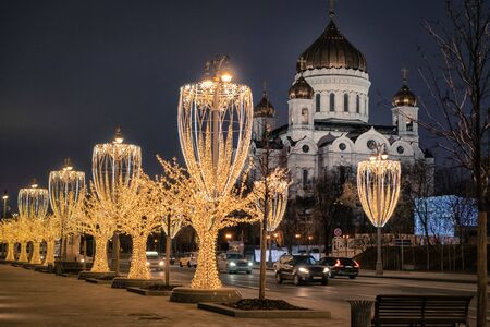 Photo for Cathedral of Christ the Saviour and illuminated street in christmas decorations, Moscow, Russia. - Royalty Free Image