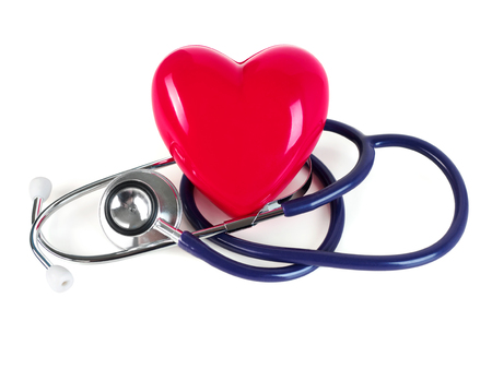 Red toy heart and stethoscope on white background. Healthcare, medical, cardiology and prevention of cardiovascular diseases concept.