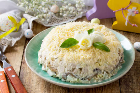 Photo for Festive snack on Easter table. Salad with eggs, chicken, mushrooms and cheese. - Royalty Free Image