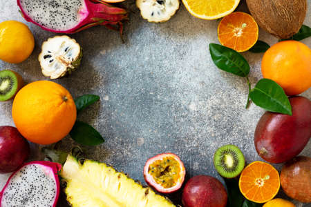 Photo for Exotic asia fruit background. Assorted ripe juicy tropical summer seasonal fruits on a gray stone background. Top view flat lay background. Copy space. - Royalty Free Image