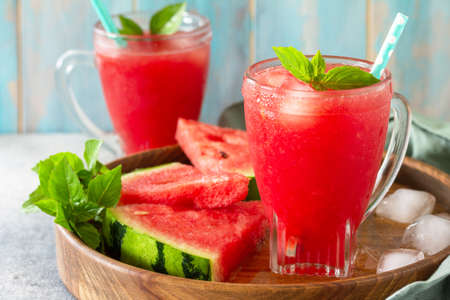 Photo pour Summer cold drink. Refreshing Watermelon drink in glasses and slices of watermelon on a stone tabletop. - image libre de droit