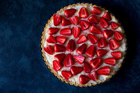 Photo for Fresh strawberry pie on dark blue background, top view, free space - Royalty Free Image