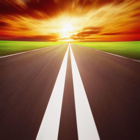 Photo pour Road with motion blur at sunset  - image libre de droit