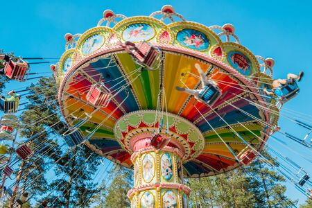 Photo for Kouvola, Finland - 18 May 2019: Ride Swing Carousel in motion in amusement park Tykkimaki - Royalty Free Image
