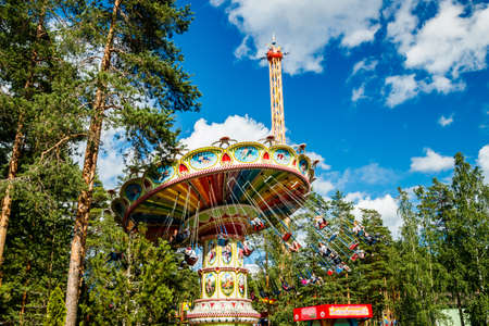Photo for Kouvola, Finland - 14 July 2020: Rides Swing Carousel and Star Flyer in motion in amusement park Tykkimaki at summer sunny day - Royalty Free Image